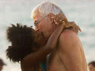 Cuban woman kisses German tourist on Santa Maria Beach, Cuba, (AP photo)
