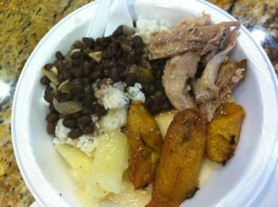 lechon, frijoles negros, plantains, yuca con mojo