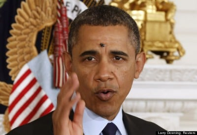 A fly lands on the head of U.S. President Barack Obama at the White House in Washington