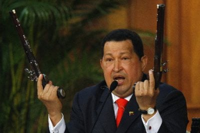 Image: File photo of Venezuela's President Chavez showing the pistols of independence hero Bolivar during a ceremony in Caracas