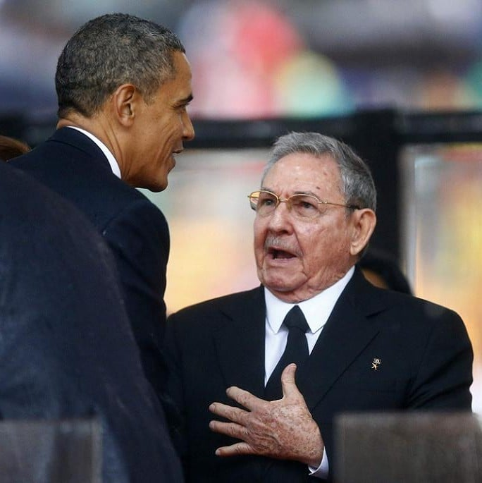 U.S. President Obama greets Cuban President Castro at the memorial service for Mandela in Johannesburg