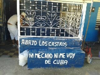 Antúnez re-paints signs on his porch