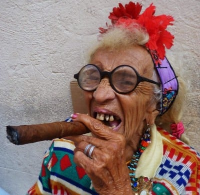 "Mrs. Fidel Castro, common-law ""wife"" of the former president, having a very good time at the cigar fair in Havana"