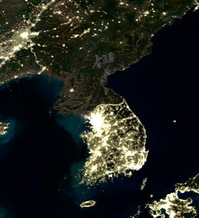 Happiness is a country without electricity, as proven by this satellite photo of North Korea at night.