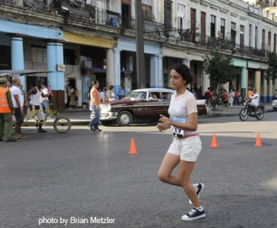 Human zoo at its best: Cuban woman wears Converse All Stars in Havana Marathon! How quaint!  How funny!