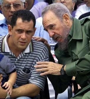 Cuban President Fidel Castro (R) talks w