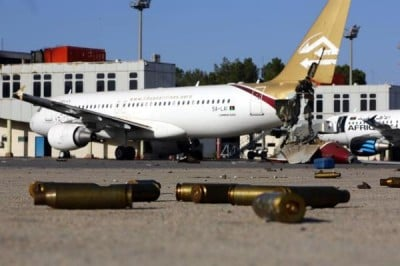 A picture taken on August 26, 2014, shows bullet casing and damaged airplanes on the tarmac at Tripoli international airport in the Libyan capital after fighters from the Fajr Libya (Libyan Dawn) coalition captured the airport.