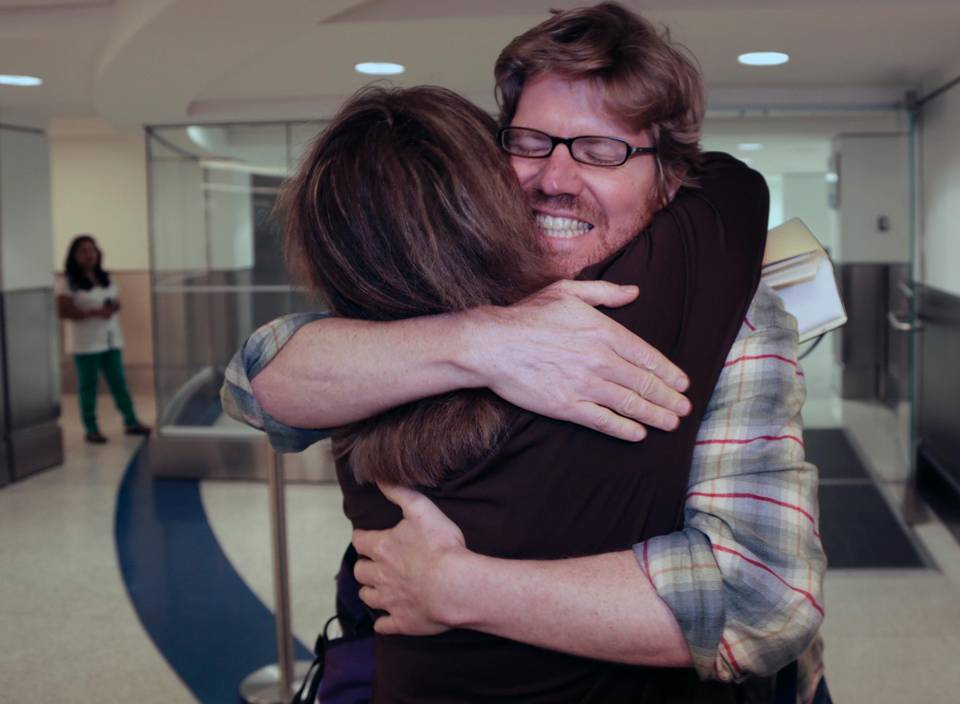 Colleague Luisa Yanez, left, gives Jim Wyss, a welcome hug upon his arrival. Miami Herald reporter Jim Wyss arrived at Miami International Airport after being detained by Venezuela for three days on Sunday, November 10, 2013.