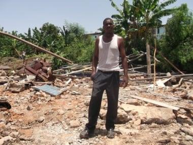 Pastor Esmir Torreblanco stands among the ruins of his home in Santiago de Cuba where he led Establishing the Kingdom of God Church