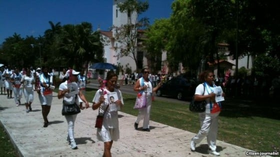 Ladies in White peacefully marching out of St. Rita Church