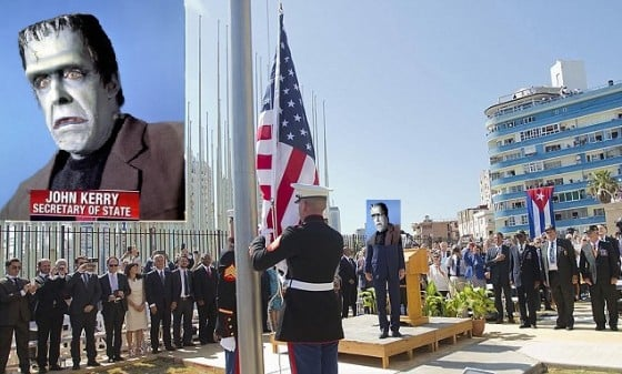 U.S. Secretary of State John Kerry (C) stands with other dignitaries as members of the U.S. Marines raise the U.S. flag over the newly reopened embassy in Havana, Cuba, August 14, 2015. Watched over by Kerry, U.S. Marines raised the American flag at the embassy in Cuba for the first time in 54 years on Friday, symbolically ushering in an era of renewed diplomatic relations between the two Cold War-era foes. REUTERS/Pablo Martinez Monsivais/Pool - RTX1OA3V