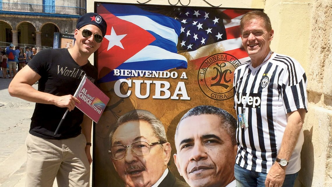 "From Al Ferguson's Facebook page: ""FINALLY, I AM CUBAN: did our final ""Gay Cuba Cruise"" our third. Amazing. Huge success. Didn't post much yet. BUT, this time I acted like a Cuban. In Havana even got off the ship and stayed overnight in a Cuban nationals hotel. Then reboarded the ship. Plan to tell you all about it including a 5 am house party with 25 gay lawyers, doctors and Indian Chiefs. ""FINALLY, I AM CUBAN"" means I threw myself into the experience. And I am a better man for doing it. — with Edward Sotomayor (on left in hat) and Al Ferguson (right) in Havana, Cuba."""