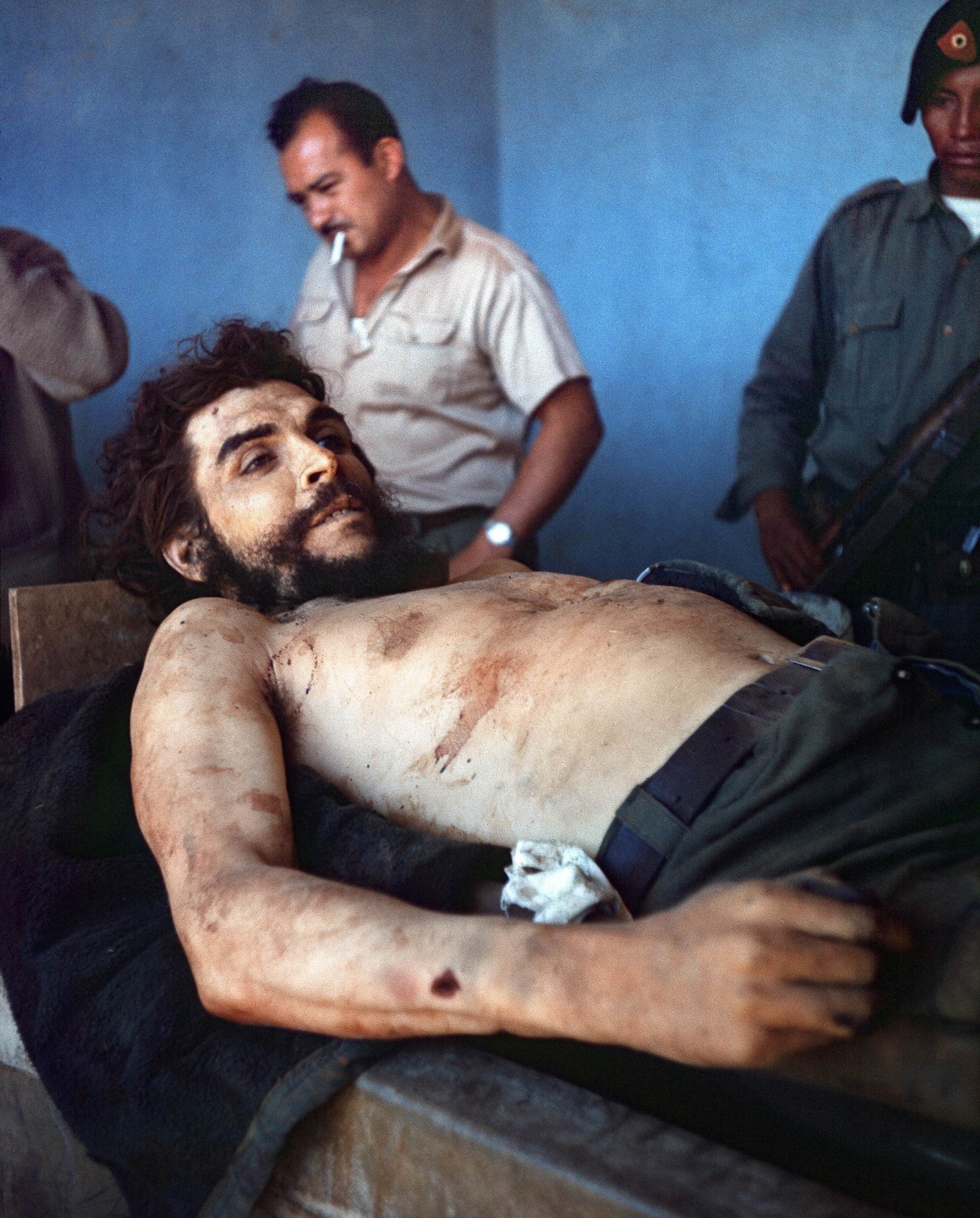 "TO GO WITH AFP STORY BY GABRIEL RUBIO GIRON (FILES) A picture taken on October 10, 1967 shows the body of Ernesto ""Che"" Guevara, the Argentine-born hero of Latin American revolutionaries is on public display in Vallegrande. Lost for half a century, historic photographs of Cuban revolutionary Che Guevara taken by an AFP photographer shortly after his execution have come to light in a small Spanish town. The photographs belong to Imanol Arteaga, a local councillor in the northern Spanish town of Ricla. He inherited them from his uncle Luis Cuartero, a missionary in Bolivia in the 1960s. AFP PHOTO/ MARC HUTTEN"