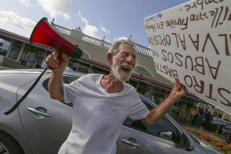 Eloy Angulo, 79, a former Cuban political prisoner, protests outside the Cafe Versailles in Little Havana