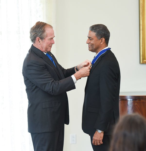 President Bush awards the Presidential Medal of Freedom to Dr. Oscar Biscet