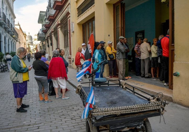 Cubans line up to buy food in Havana. (Photo by YAMIL LAGE/AFP)